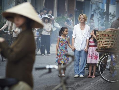 'THE MOTHER TERESA OF VIETNAM.' Deirdre O'Kane as Christina Noble with Vietnamese street children.