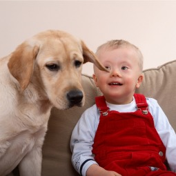 A boy and his dog. New prenatal tests for Down Syndrome could mean far fewer children will be allowed to reach birth.