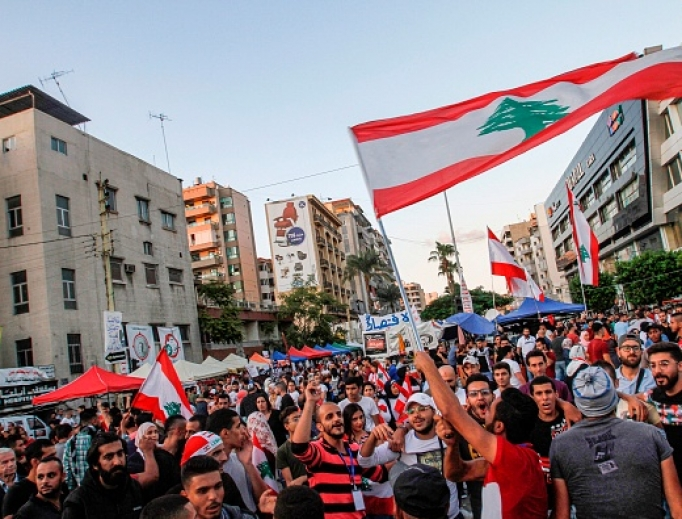 Lebanese anti-government protesters celebrate the resignation of Prime Minister Saad Hariri in the southern city of Sidon on Oct. 29 on the 13th day of anti-government protests.