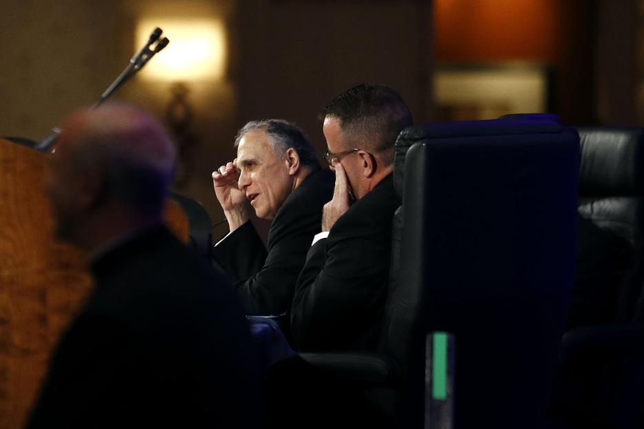 Cardinal Daniel DiNardo, president of the USCCB, left, at the USCCB's annual fall meeting Tuesday in Baltimore.