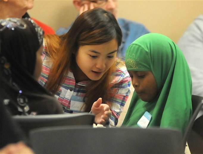 Lisa Tu, a senior at the College of St. Benedict in St. Joseph, talks with 9-year-old Ayan Musse at a Sept. 22 Christian-Muslim dialogue meeting at St. Joseph's Church in St. Joseph, Minnesota.
