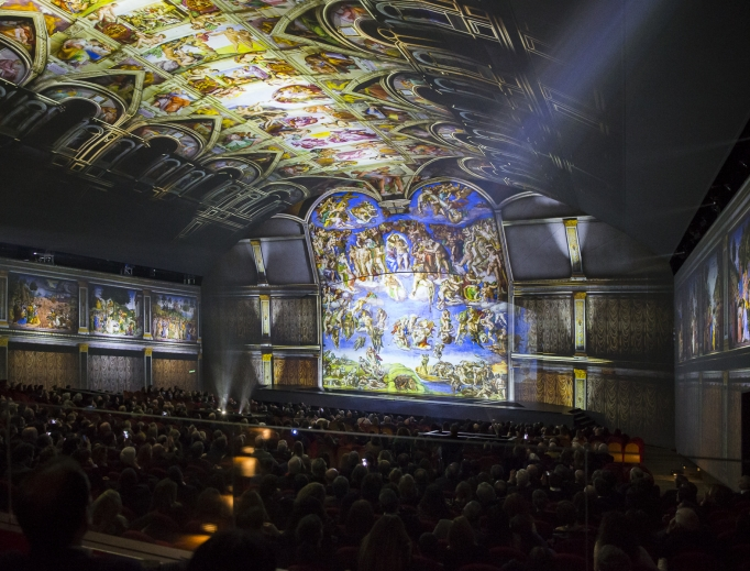 Above, high-definition, 270-degree light projections transport the audience into the Sistine Chapel to learn about each major painting in 'Universal Judgment: Michelangelo and the Secrets of the Sistine Chapel.'  Below, an actor highlights the election of Pope Clement VII,who commissioned Michelangelo to paint The Last Judgment above the altar, completing the Sistine Chapel we can now see today.