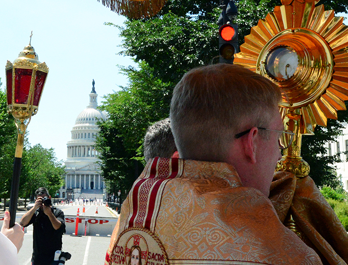 The 'Corpus Christi in the Capital' procession approaches the U.S. Capitol building June 23, 2019