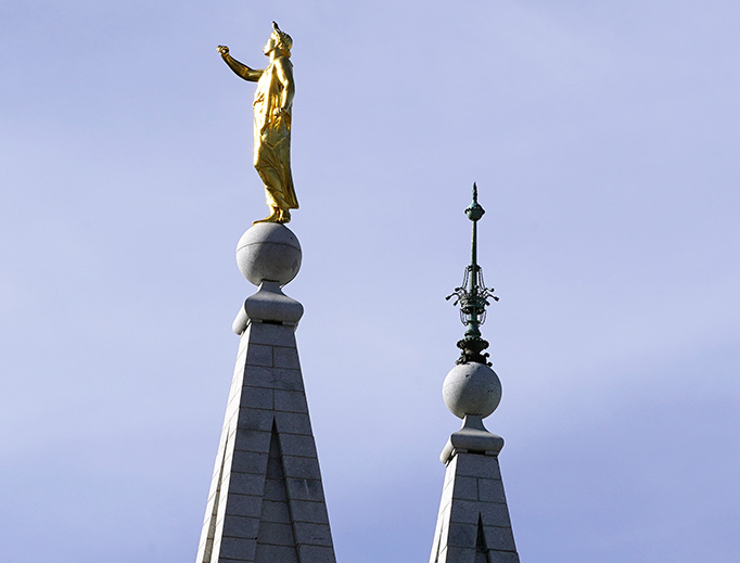An earthquake-damaged golden Moroni statue sits atop the Mormon Temple during the 190th Annual General Conference of the Church of Jesus Christ of Latter-day Saints on April 4 in Salt Lake City, Utah.