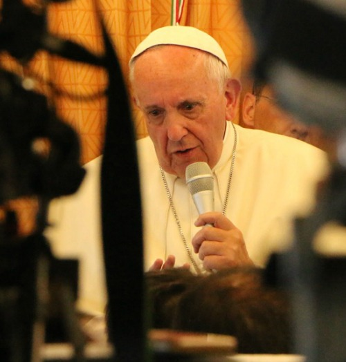 Pope Francis speaks with journalists on his flight to Rome at the conclusion of his June 24-26 papal visit to Armenia.