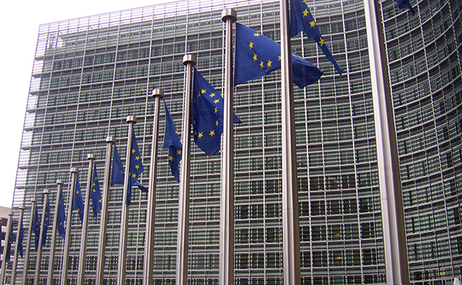 EU flags in front of the Berlaymont building, head office of the European Commission (Amio Cajander, CC BY-SA 2.0)