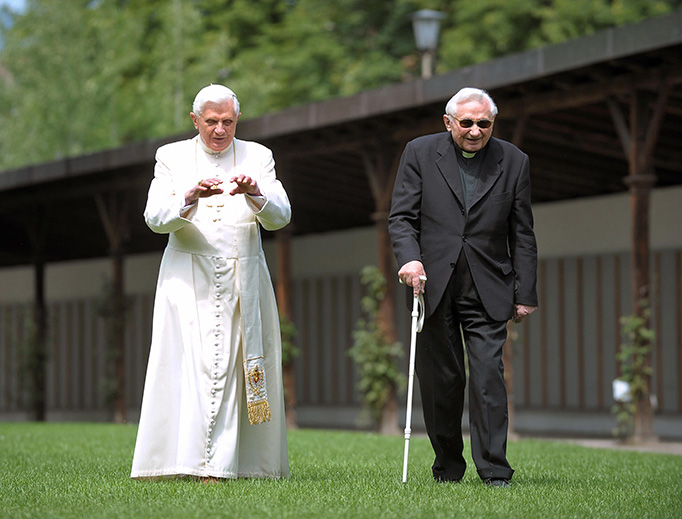 Pope Benedict XVI walks with his brother, Msgr. Georg Ratzinger, in Bressanone, Italy, July 31, 2008.