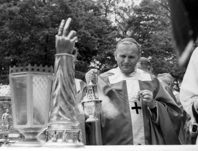 Archbishop Karol Wojtyła, the future Pope St. John Paul II, censes the altar at Mass in 1966
