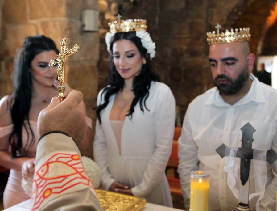 A couple gets married with only close relatives in attendance amid the COVID-19 pandemic on April 18, 2020, at a church in the Hadath region near Beirut, Lebanon.