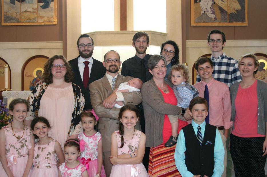 The Ekblad family at baby Jude's baptism at Christ the King Catholic Church in Ann Arbor, Michigan.