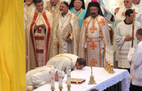 Pope Francis kisses the altar during Mass in Bethlehem's Manger Square on May 25.