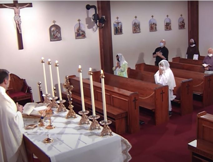 GATHERING IN PRAYER. Mass is social distanced at EWTN on July 31.