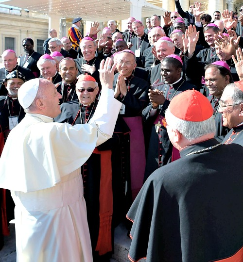 Pope Francis meets with cardinals and bishops in St. Peter's Square during the general audience on Feb. 24.