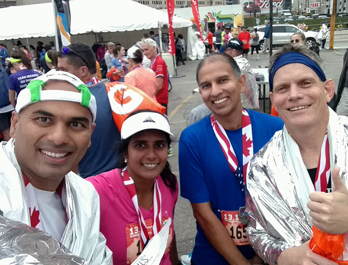 After the International Half-Marathon in Detroit Sunday October 15, Tom Nash (far right) and his friends — (from L to R) Phani, Sravi and Ramesh — exult in their accomplishments.