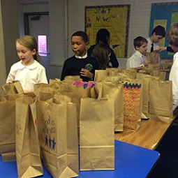 Students at St. Peter's School in Washington make breakfast bags for the homeless.