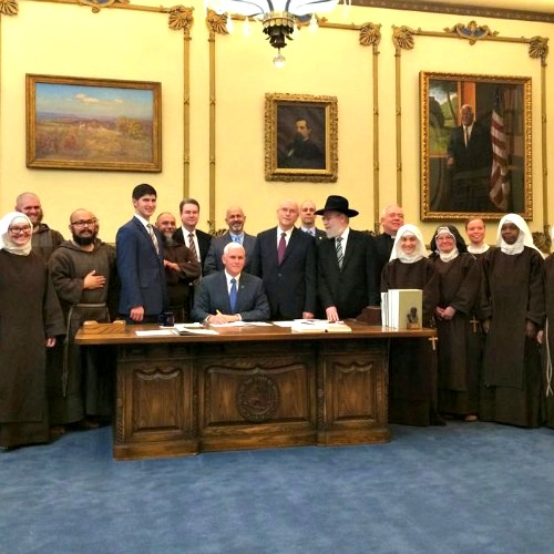 Indiana Gov. Mike Pence signs the state's religious-freedom bill on March 25.