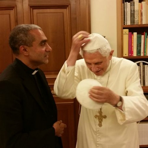 Msgr. Anthony Figueiredo exhanges a zucchettos with Pope Emeritus Benedict XVI at the Vatican on Nov. 7.