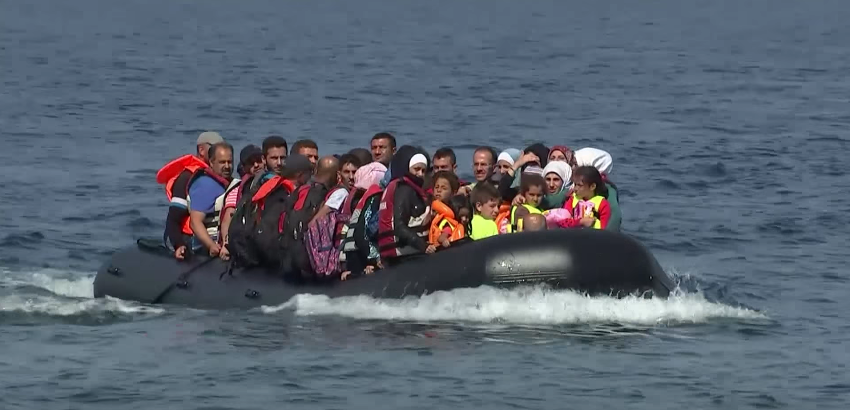 Refugees arriving in Lesbos on an overloaded dingy last September.
