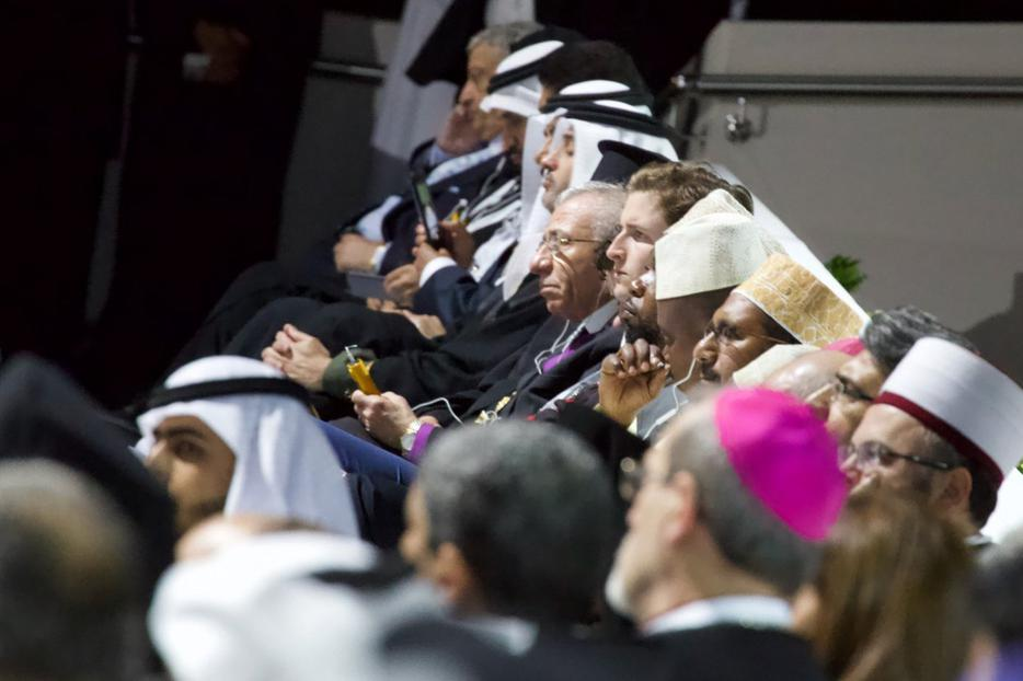 Archbishop Pierbattista Pizzaballa (foreground), apostolic administrator of the Latin Patriachate of Jerusalem, sits among followers of other religions at interreligious meeting in Abu Dhabi, Feb. 4, 2019.