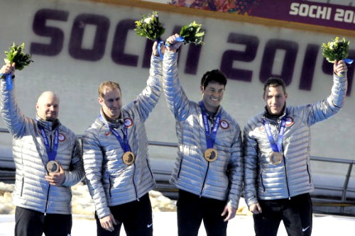 Curt Tomasevicz, second from left, poses with his bobsled teammates who won a bronze medal at the Sochi Winter Olympics.