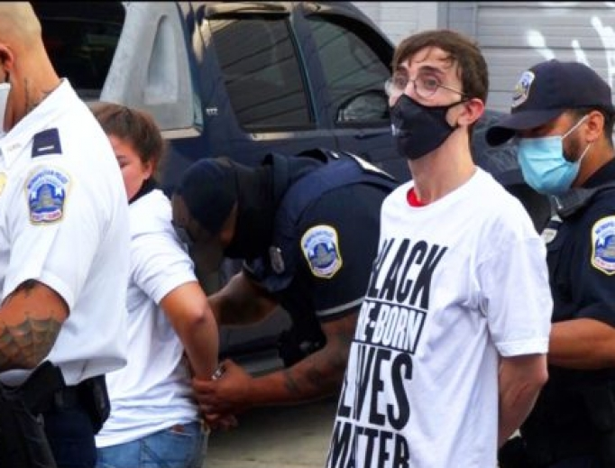 Metropolitan Police arrest a Students for Life volunteer, Aug. 1, 2020.