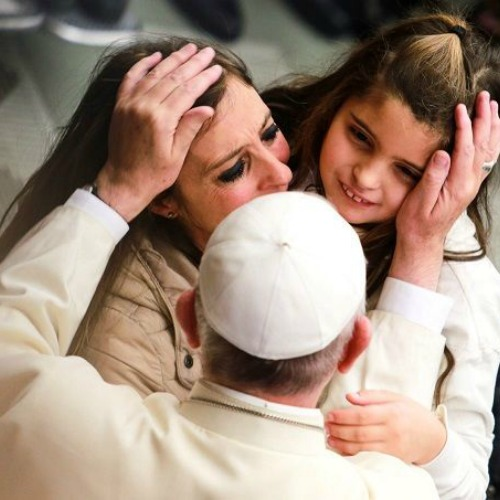 Pope Francis greets pilgrims during his general audience Jan. 13.