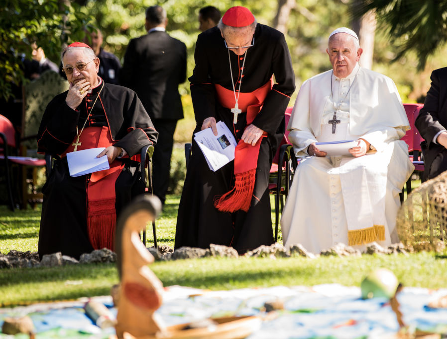 Pope Francis and Cardinal Cardinal Cláudio Hummes, President of the Pan-Amazonian Ecclesial Network (REPAM), sit in front of a statue representing Pachamama as they celebrate the Feast of St. Francis of Assisi at the Vatican Gardens Oct. 4, 2019.