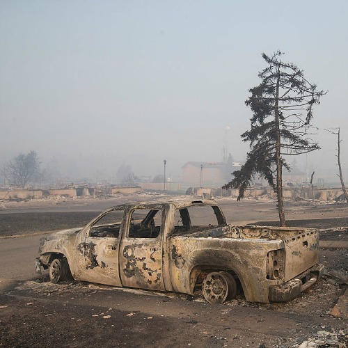 Home foundations and shells of vehicles are nearly all that remain in a residential neighborhood destroyed by a wildfire on May 6, in Fort McMurray, Alberta.