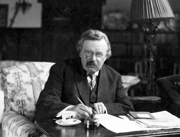 G.K. Chesterton works in his study.