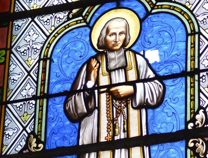 St. Jean Vianney is portrayed in a stained-glass window.