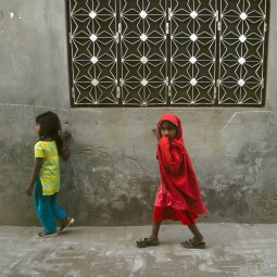 WALKING IN FEAR. Girls walk through a street in Gojra town, located in Punjab province. Residents of the neighborhood, known as Christian Colony, are haunted, since 2009, by memories of Muslim attacks on families there.