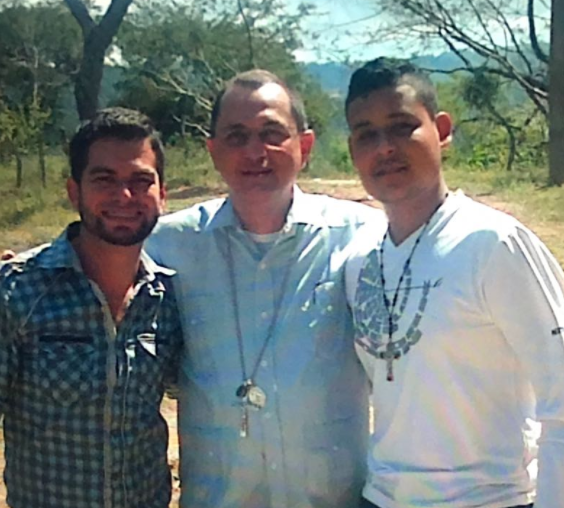 Bishop Pineda with two unidentified seminarians from the Major Seminary of Suyepa.