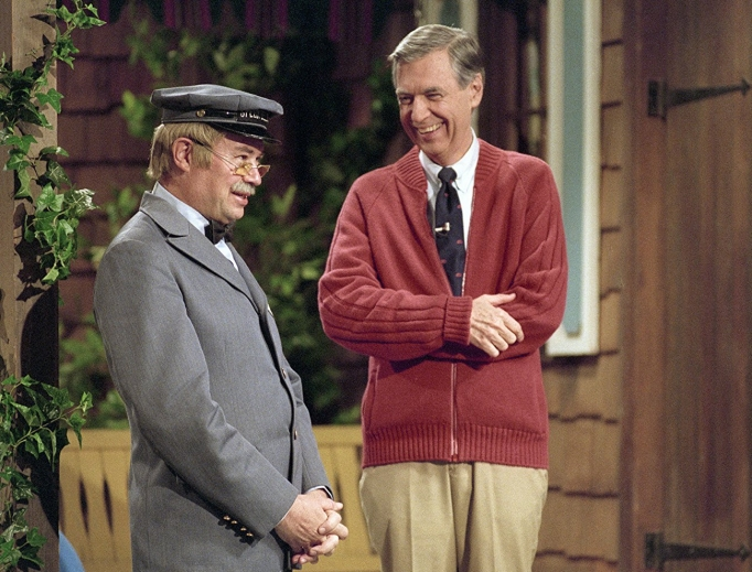 Above, a scene of David Newell, who played mailman Mr. McFeely, and Fred Rogers from Mr. Rogers' Neighborhood is included in Won't You Be My Neighbor?; below, Rogers with his puppet alter ego, Daniel Stripéd Tiger.