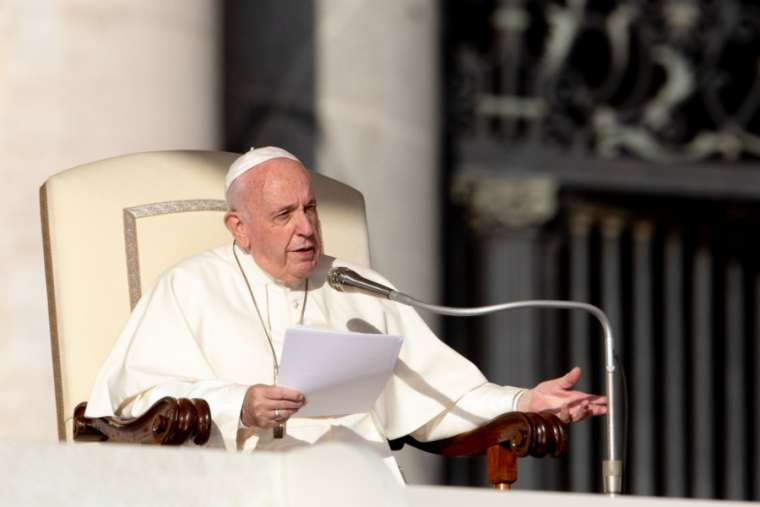 Pope Francis speaks at the general audience Oct. 23.