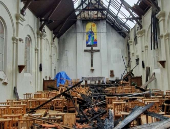 The aftermath of a fire at the Parish of St. Paul in Corbeil-Essonnes, France, July 4, 2020.