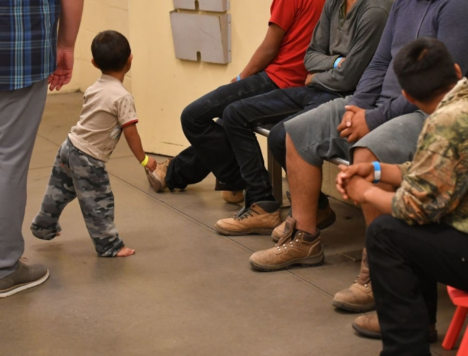 Young children are shown with their families at the U.S. Customs and Border Protection Facility in Tucson, Arizona, during a visit by First Lady Melania Trump June 28.