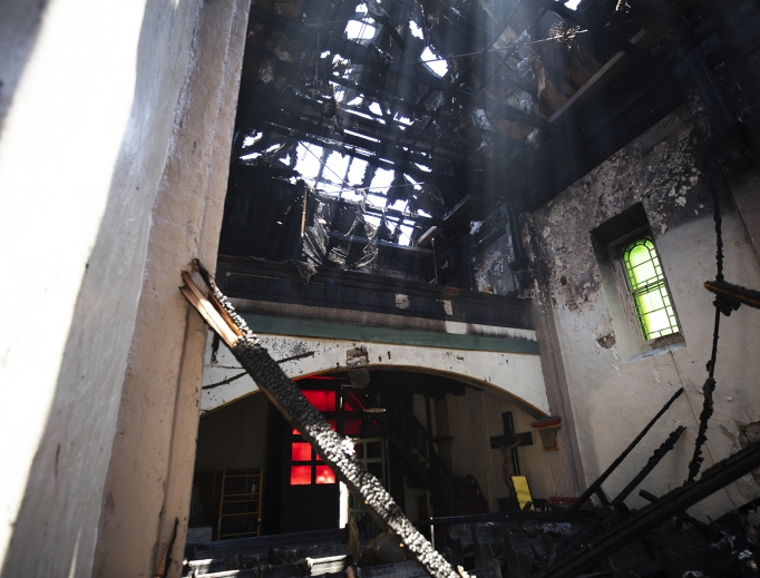 Mission San Gabriel, which was founded in 1771 by St. Junípero Serra, was devastated by fire July 11. Auxiliary Bishop David O'Connell of the San Gabriel Pastoral Region of the Archdiocese of Los Angeles was on hand to survey the fire-caused damage.