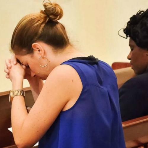A woman prays at the Orlando prayer vigil at St. James Cathedral, June 13.