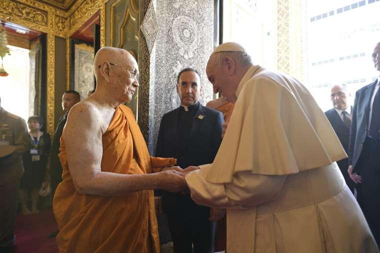 Pope Francis greets His Holiness Somdej Phra Maga Muneewong at the Wat Ratchabophit Sathit Maha Simaram Temple in Bangkok Nov. 21.