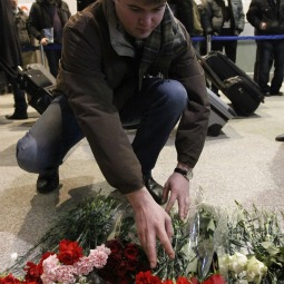 A man lays flowers on the floor Jan. 25 in memory of those killed in a bombing at Moscow's Domodedovo Airport. Terrorists detonated a bomb Jan. 24 at the Moscow airport, killing at least 35 people and wounding more than 150, Russian authorities said.