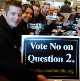 """Some members of a street team gather after a """"No on Question 2"""" outreach in Boston."""