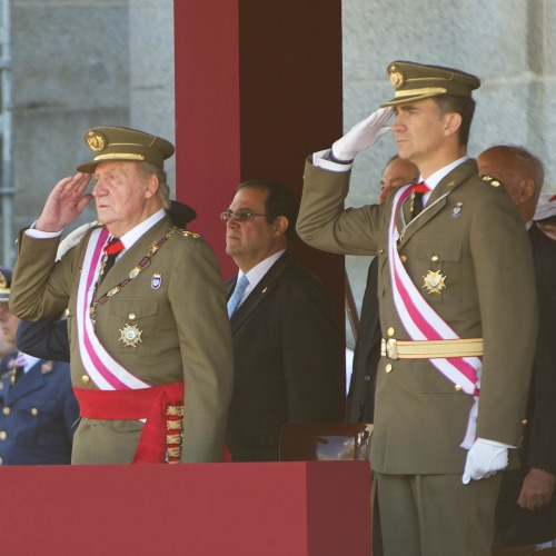 King Juan Carlos of Spain (l) and Prince Felipe of Spain at a June 3 public event in San Lorenzo de El Escoria, Spain.