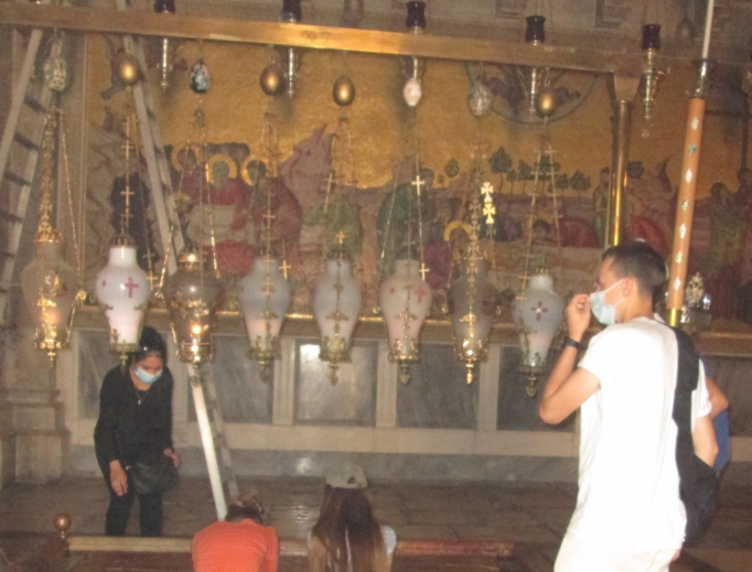 Closed for two months to stop the spread of the novel coronavirus, the Church of the Holy Sepulcher is now open to the public, but only 50 people at a time may pray inside. Above, pilgrims living in Israel pray in the Church of the Holy Sepulcher.