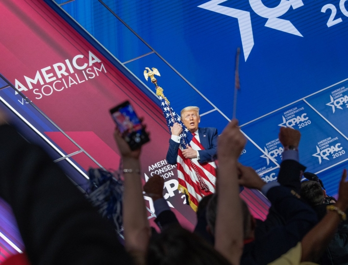 President Trump embraces the American flag at CPAC, 2019.