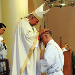 CHAPLAIN PRIEST. Bishop Sam Jacobs of Houma-Thibodaux, La., ordains Stu King a Catholic priest during a Mass May 26 at the Cathedral of St. Francis de Sales in Houma.