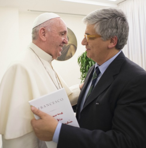 Pope Francis with Italian journalist Andrea Tornielli during the book debut of The Name of God Is Mercy on Jan. 12.