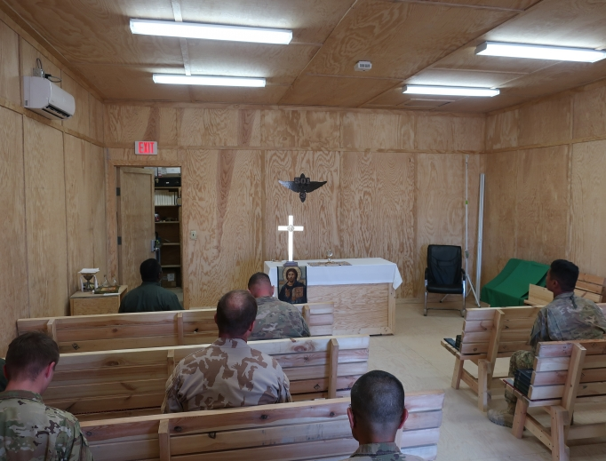 Father Michael Creagan, shown below holding up the jaguar mascot of the Catholic school at St. Joseph parish in West St. Paul, Minnesota, made sure soldiers in Afghanistan had access to Mass (his Mass kit is shown below) and adoration (shown above).