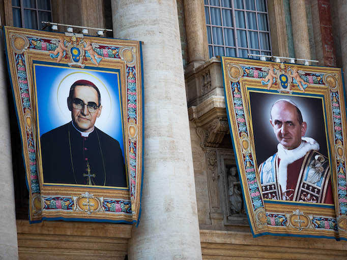 Banners hanging in front of St. Peter's Basilica during the canonization mass of Sts. Paul VI (right) and Oscar Romero (left).