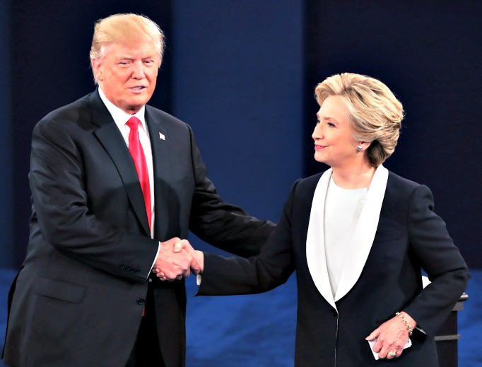 Republican presidential nominee Donald Trump shakes hands with Democratic presidential nominee Hillary Clinton during the town hall debate at Washington University on Oct. 9 in St Louis. The two will attend the annual Al Smith fundraiser in New York tonight.