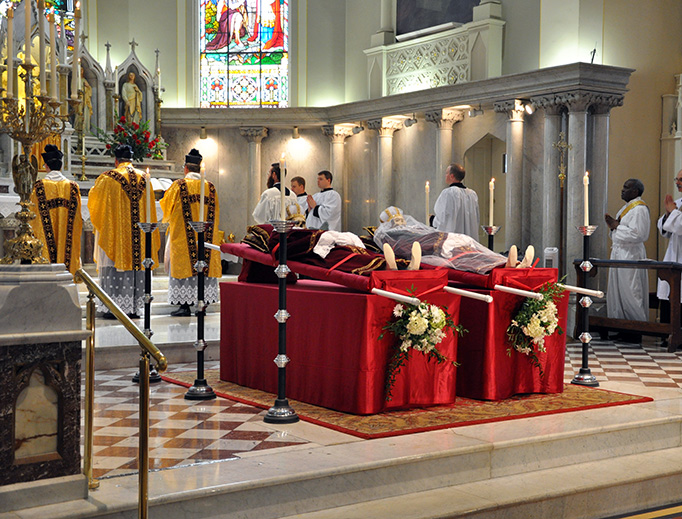 ABOVE: Mass is offered at St. Martin de Tours in Louisville, Kentucky, with the relics of the two saints in the front. BELOW: Relics at the Maria Stein Shrine of the Holy Relics; (2) First-class relic at St. Martin de Tours.
